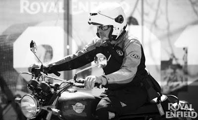 Man in helmet astride a Royal Enfield INT650 motorcycle.
