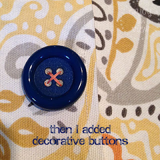 print pillow cover with decorative buttons