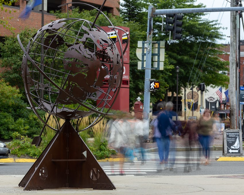 Portland, Maine USA September 2018 photo by Corey Templeton. People passing by the Untitled-Armillary sculpture on Commercial Street in the Old Port.