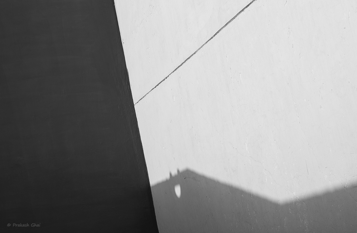A Black and White Minimalist Photo composed by a combination of Light Shadows and Lines