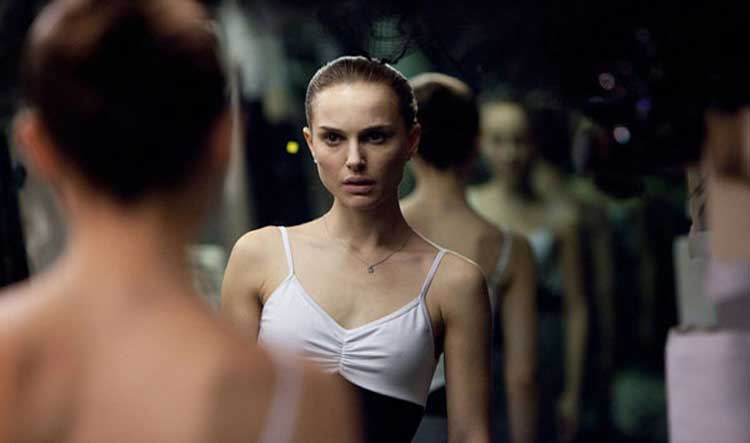 Nina Sayers looks in the mirror and doesn't like what she sees in Black Swan.