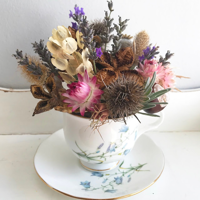 Dried Floral Cup Of Flowers Arrangement