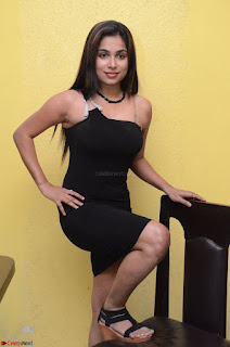 Vrushali Gosavi in strapless Short Black Dress At Follow Follow U Audio Launch 039.JPG