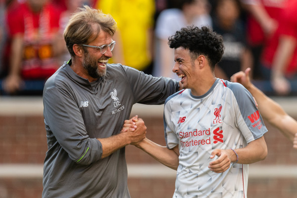 Head coach Jurgen Klopp celebrates with Curtis Jones #48 after Liverpool defeated Manchester United during second half of the International Champions Cup 2018 at Michigan Stadium on July 28, 2018 in Ann Arbor, Michigan. Liverpool defeated Manchester United 4-1