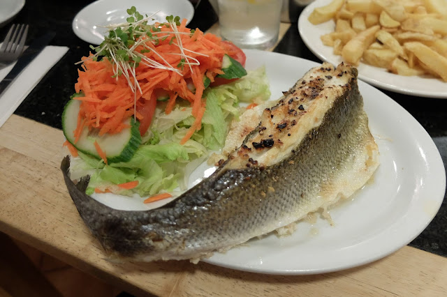 seabass on a plate with salad