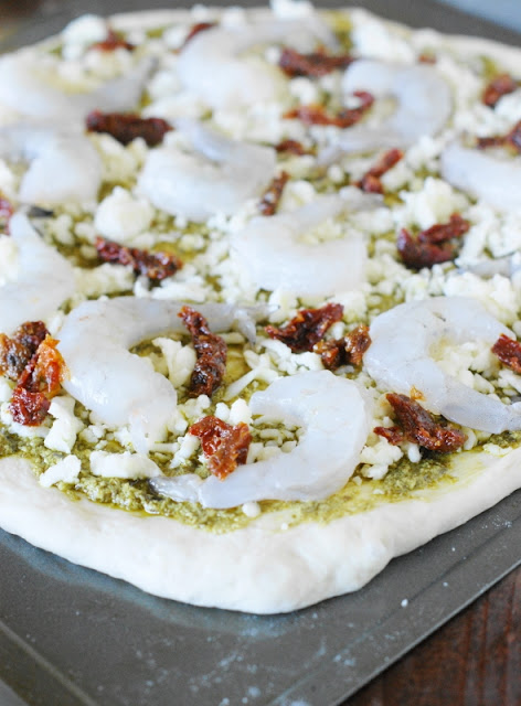 Shrimp & Pesto Pizza with Sun-Dried Tomatoes~ An amazing pizza flavor combination that may just become a new family favorite!   www.thekitchenismyplayground.com