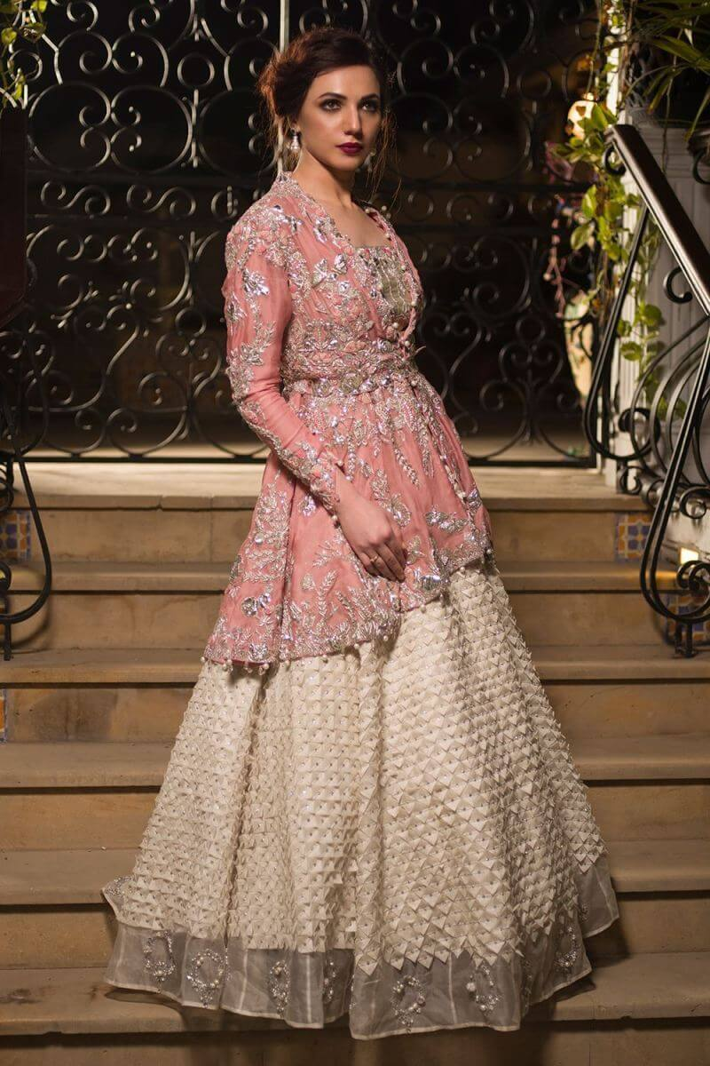 This pink organza bridal dress by Nida Azwer Pakistani bridal outfits is a perfect attire for the barat bride