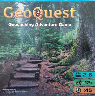 The front cover of the box for Geoquest. The title, in yellow, with a compass rose in the center of the capital letter Q, in the upper right, with the subtitle 'Geocaching Adventure Game', superimposed over a photo of wooden steps built into a trail leading through a forest.