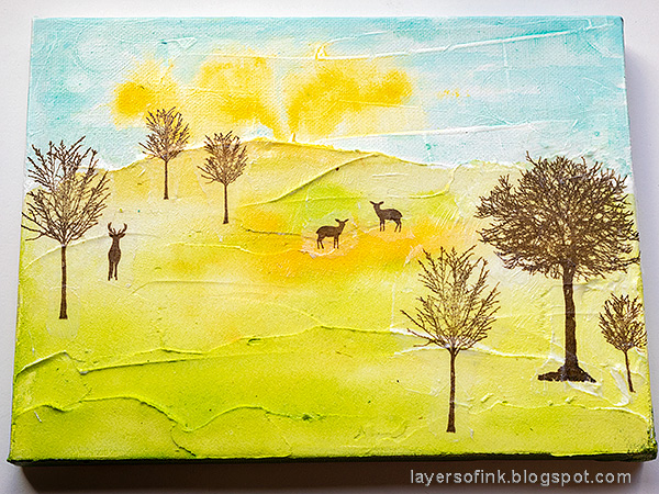 Layers of ink - Spring Canvas Mixed Media Tutorial by Anna-Karin Evaldsson. Adhere the tissue paper trees.