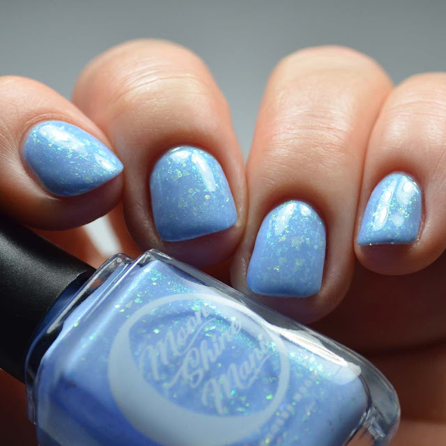 periwinkle blue nail polish with flakies low light swatch