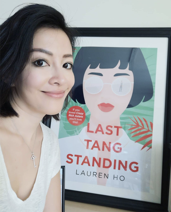 Last Tang Standing author Lauren Ho poses with the book cover