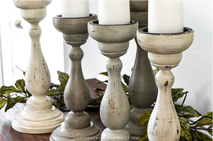 Collection of painted wood candleholders