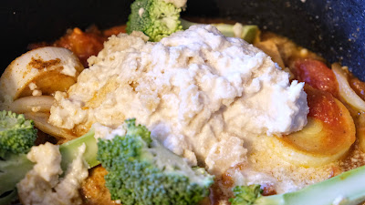 Dollop of cashew cream in a saucepan with veg