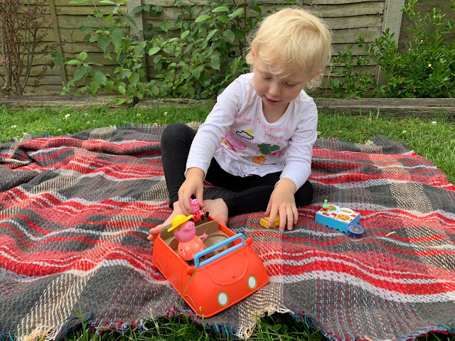 putting peppa pig in her toy car