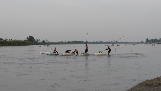 Locals collecting stons from Mahananda river