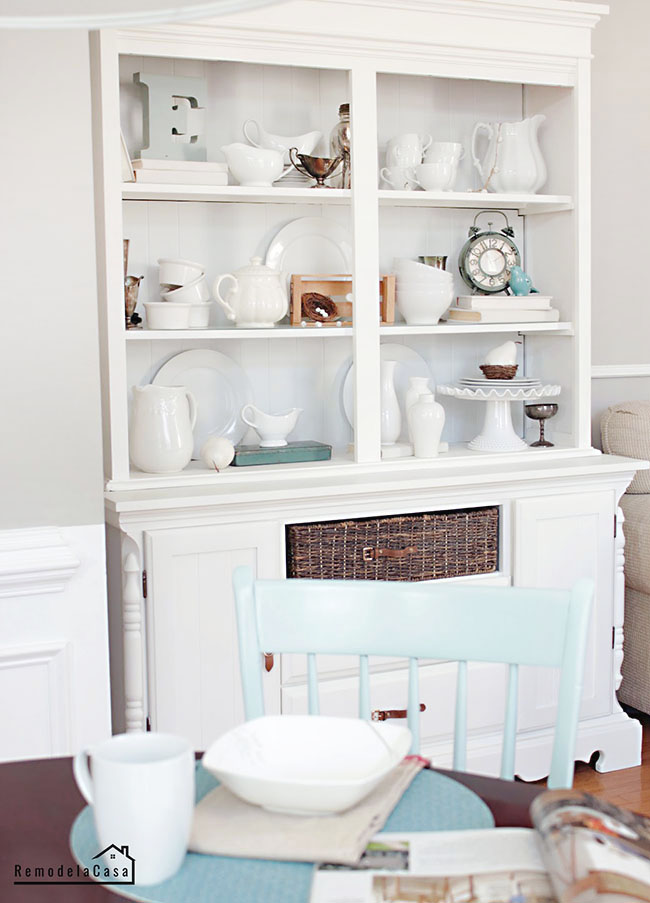 a drab, dark hutch is transformed with white paint