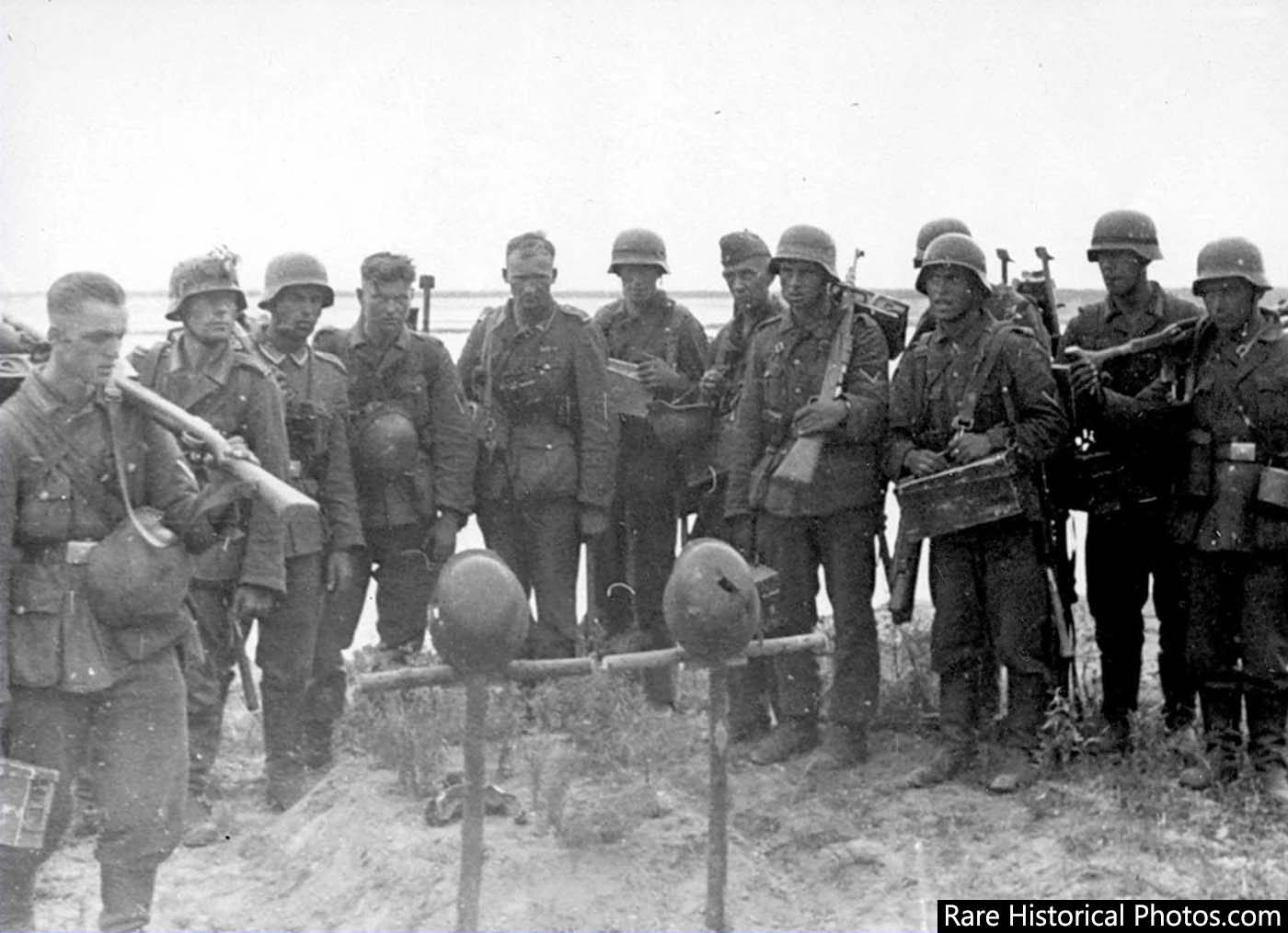 German soldiers at the graves of their fallen comrades at Stalingrad.