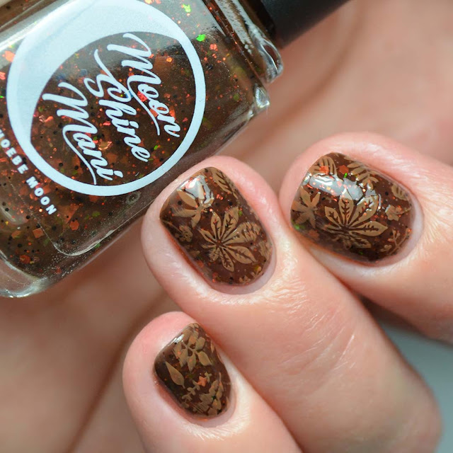 fall leaf nail art stamping on three fingers