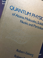 Quantum Physics of Atoms, Molecules, Solids, Nuclei, and Particles, by Eisberg and Resnick, superimposed on Intermediate Physics for Medicine and Biology.