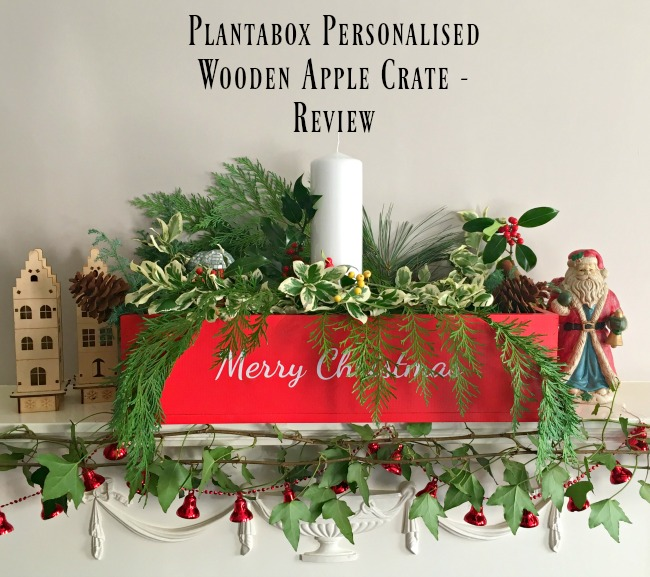 Plantabox-personalised-wooden-apple-crate-text-over-image-of-red-table-centrepiece-with-white-text-Merry-Christmas