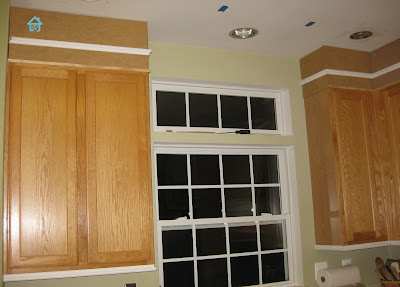oak cabinets being spruce up with moldings