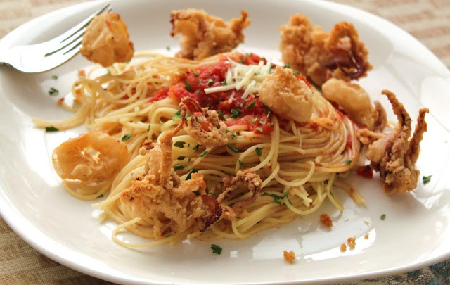 this is fried calamari on top of linguine and marinara sauce