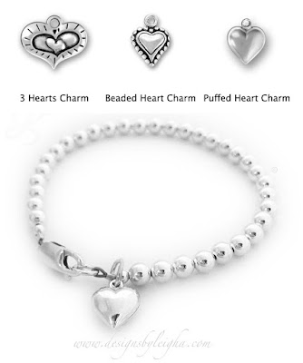 This Heart Bracelet is shown with a Puffed Heart Charm and shown with a lobster claw clasp.