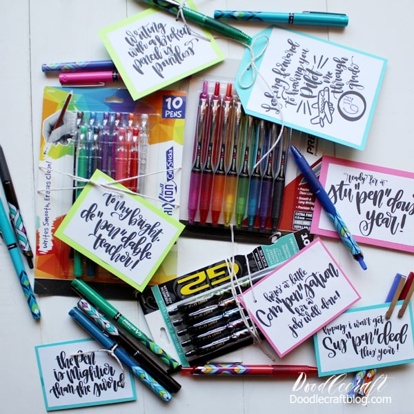 Pilot Pens with clever puns printed on tags scattered on table showcasing many varieties and colors of Pilot pens, precise, G2 and Frixion color sticks