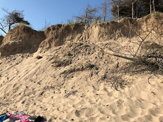 Beachgoers are being warned to be careful near sand dunes after a young girl escaped serious injury after becoming trapped underneath a collapsed sand dune on Newborough Beach yesterday afternoon.         HM Coastguard was alerted to the incident just after 5.15pm and Rhosneigr and Bangor...