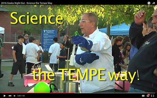 snapshot from video featuring a scientist performing some kind of experiment for participants.  Text: Science the Tempe Way!