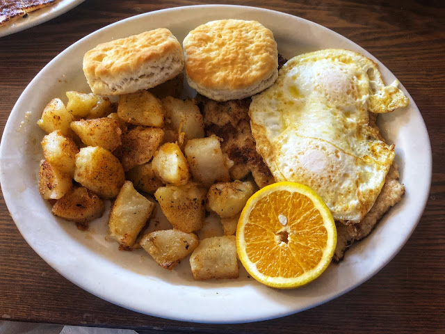 schnitzel with poached eggs, German potatoes, and biscuits