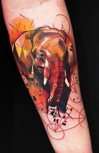 Um retrato de um elefante é criado utilizando uma paleta de cores de vermelho e amarelo e é embelezado com formas geométricas na base da imagem.