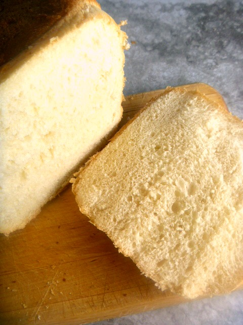 Light and fluffy homemade bread straight from your bread machine.  Hot from the oven and slathered with butter will have you swooning for more! - Slice of Southern