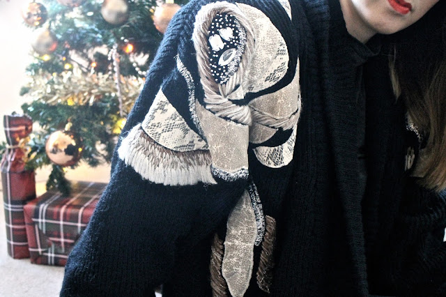 Close up of a black and gold vintage cardigan
