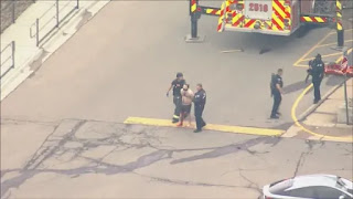 It appears his right leg was covered in blood. He was led to an ambulance and taken away to a local hospital. Police say they are the only other person who was injured aside from those who were killed.