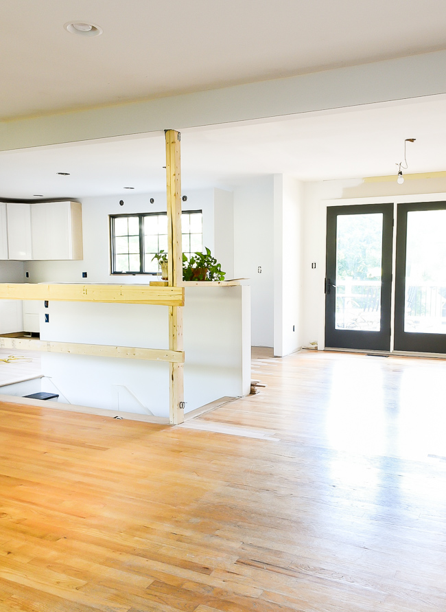 Open floor plan in a rancher style home, white shaker style cabinets