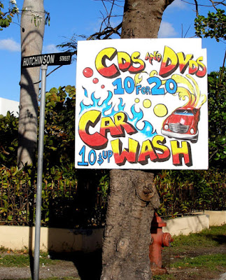 CD, DVD, Car Wash Combo sign.