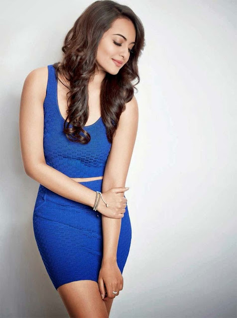 Sonakshi Sinha wearing a blue body hugging dress and a lot of oomph on her sleeves