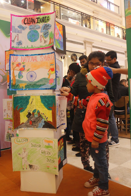 Kid enjoying the drawing exhbition at DLF Promenade