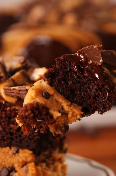 This mashup cake from Delish.com squeezes layers of peanut butter cookie dough in between layers of chocolate cake and it's as amazing as it sounds.