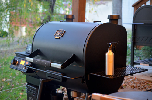 Oklahoma Joe's Rider DLX Pellet Grill in action in my lower grilling area.