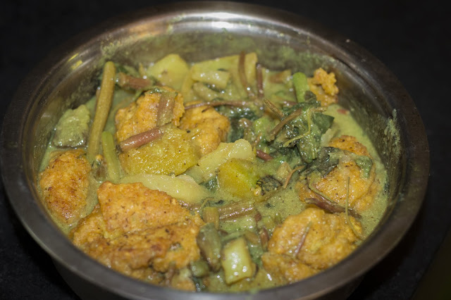 Lau data ( stem of gourd) and daler bora ( Lentil Fritters) curry