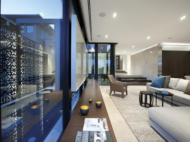 Photo of modern furniture by the window of amazing modern home in Melbourne