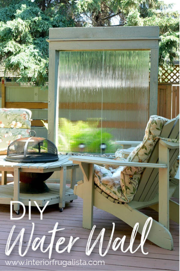 An amazing DIY Outdoor Water Wall for under $300 for a backyard deck or patio using recycled tempered glass. The outdoor fountain is also illuminated at night with solar flood lights. A budget-friendly water feature plus privacy screen for those who know how to rock power tools.