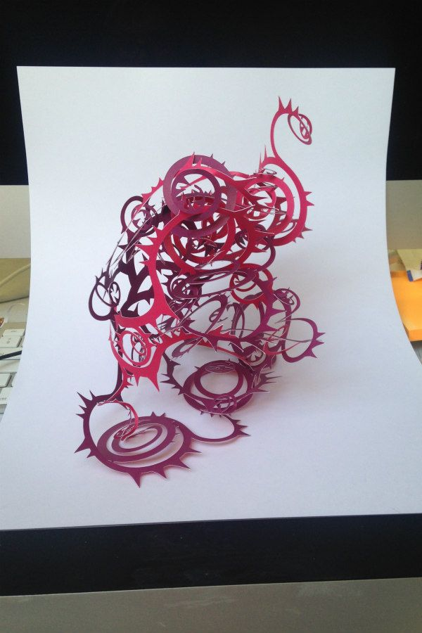 pink and purple spiral papercut formation