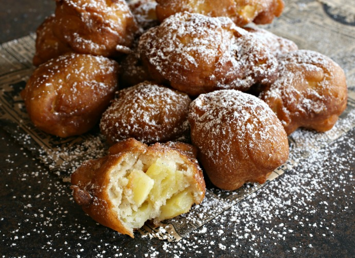 Sweet apple fritters, fried and served hot with powdered sugar.
