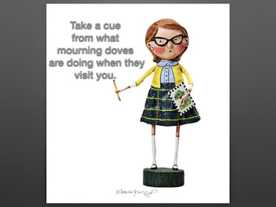 "This image features a figurine designed by Lori Mitchell who has named her Miss Teachy.   Miss Teachy is wearing a yellow cardigan and plaid skirt. She has a pencil in her right hand and is holding a book about trees in in left hand. Teachy is wearing horn rimmed glasses and the look in her eye dares students to not pay attention.  At the top left corner of my image I've included text that states, Take a cue from what mourning doves are doing when they visit you.  Mourning doves are featured in my book series, ""Words In Our Beak,"" and info re them is in another blog post @ https://www.thelastleafgardener.com/2018/10/one-sheet-book-series-info.html"