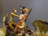 statuette indiani in canoa fucile modellino da schizzo rievocazione storica vecchio west