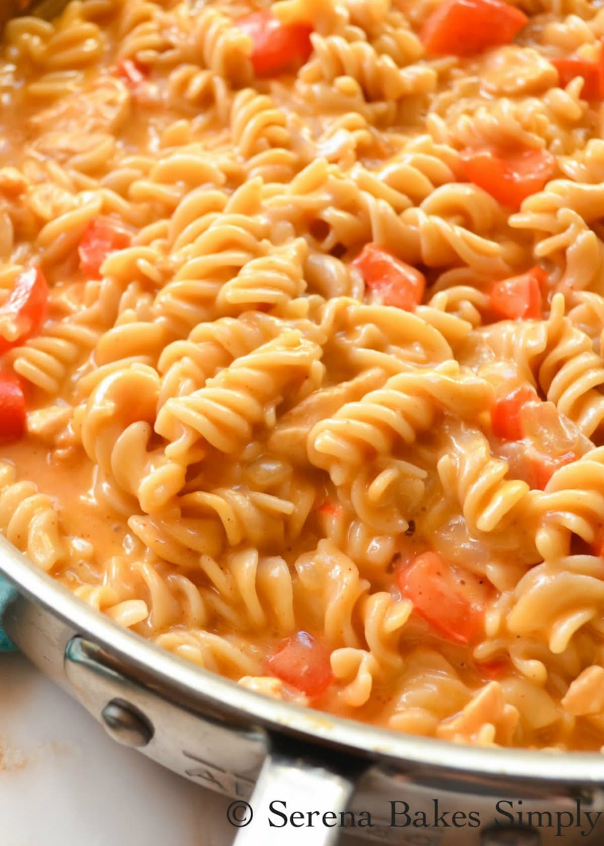Chicken Macaroni and Cheese Helper in a stainless steel pan.