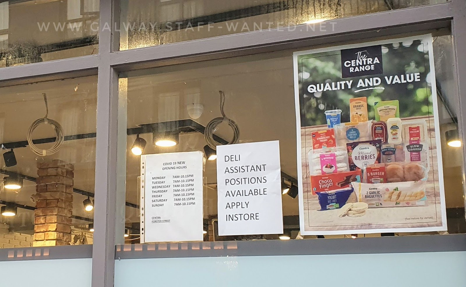 Deli assistant job advert, in between sign with opening hours for Forster Street Centra, and an advertising sign about The Centra Range - quality and value